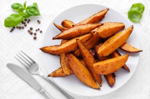 Delicious homemade sweet potato wedges on a plate.