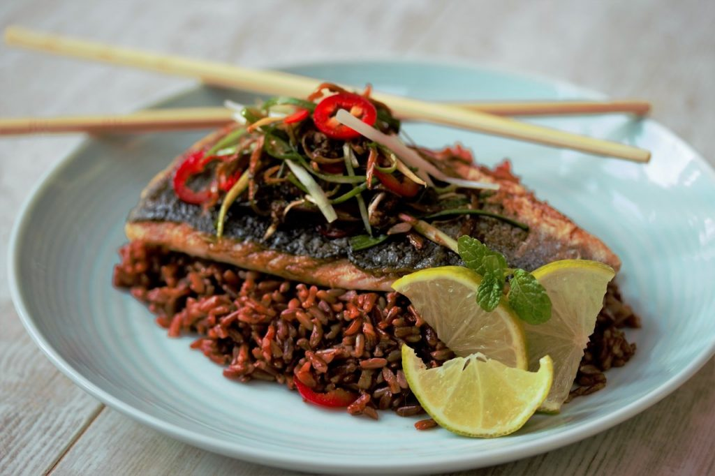 Sea bass with ginger, chilli & spring onions